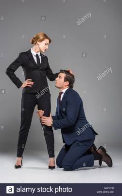 female-boss-dominating-over-scared-businessman-isolated-on-grey-feminism-concept-MWYY06